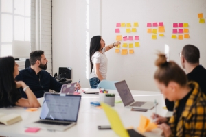 business team planning an event on a whiteboard | event planning misconceptions
