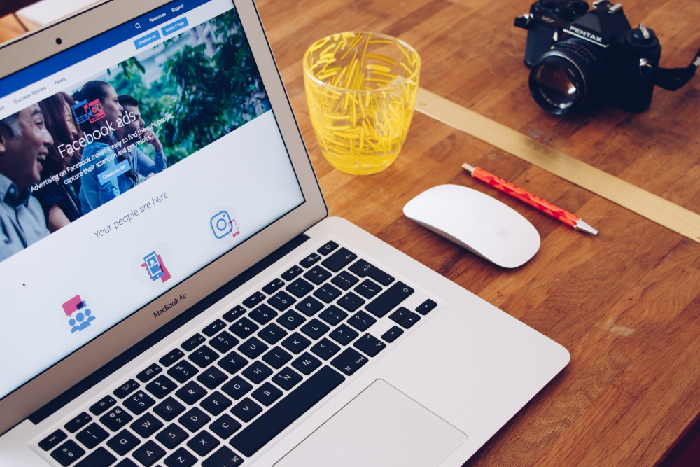 facebook ad screen on laptop | how to market a corporate event